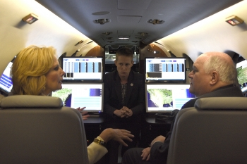NNSA Administrator Lisa E. Gordon-Hagerty, left, and Jessica McNutt, discuss the Aerial Measuring System with U.S. Rep. Ron Estes of Kansas while inside one of the newly delivered planes.