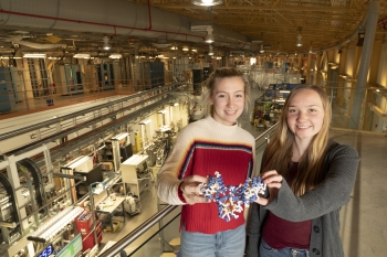 Shelter Island High School students Lauren Gurney and Emma Gallagher with a 3-D model of methylenetetrahydrofolate reductase (MTHFR), a protein involved in a range of diseases whose structure the students solved using x-rays at Brookhaven Lab.