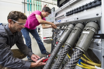 NREL researchers work on the Consolidated Utility Base Energy System.