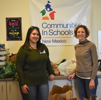 Volunteer Maribel Dominiguez, left, coordinates with Communities In Schools Site Coordinator Alex Mazares, right. CIS New Mexico for whom Maribel tutors provides students with food for the mind, body and soul.