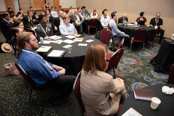 Students and faculty advisors listen intently as Solar District Cup organizers present at the Warmup Workshop at Solar Power International.