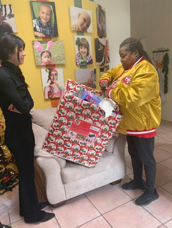 Michelle McClenehan delivers holiday toys donated by members of the 505 New Mexico Niner Empire.