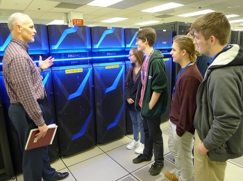 Mason Richardson, with the information technology division at Savannah River Nuclear Solutions, leads a tour of Evans High School students at the Savannah River Site Data Center.