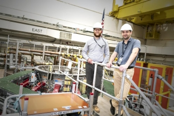 Rotational engineers Bill Harris, left, and Nick Santoro, at the National Spherical Torus Experiment-Upgrade (NSTX-U) test cell.