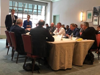 DOE Chief Information Officer Rocky Campione (pictured far right) engaged in a CES Government panel discussion on AI.