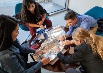 Students at the NREL Mini-Semester (from left) Melissa Perez, Jacqueline Solis-Armanta, Sean Regalado-Love, and Shannon Hamp design a solar concentrator.
