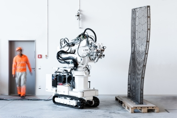 ETH Zurich's robot, In situ Fabricator, was used to build DFAB HOUSE in Switzerland, the world's first home designed, planned, and built using predominantly digital processes.