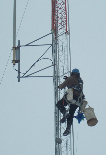 An inspector climbs a 200-foot meteorological tower at EM's West Valley Demonstration Project Site.