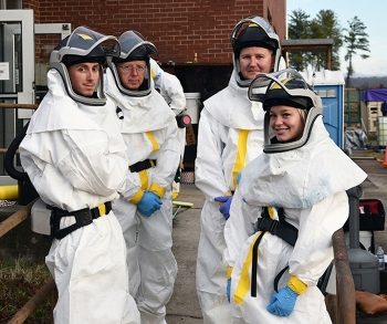 An EM crew gathers before performing deactivation work inside the K-1006 Building to prepare the facility for demolition.