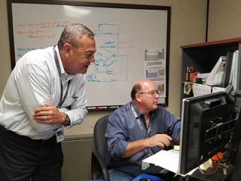 David Bowling, left, owner of Linear Path, and Phil Clark work on data automation as part of their services to UCOR, Oak Ridge's cleanup contractor.