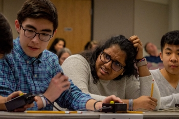 Gatton Academy students David Suarez, Hasitha Ramisetti and Jason Zhang compete in a quick-recall, fast-paced question-and-answer contest.
