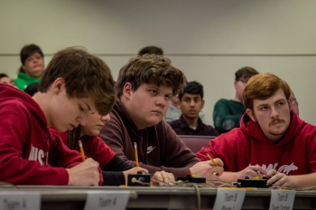 McCracken County High School team members Jake Mitchell and Ben Schofield (right) look to the moderator to find out if an answer is correct.