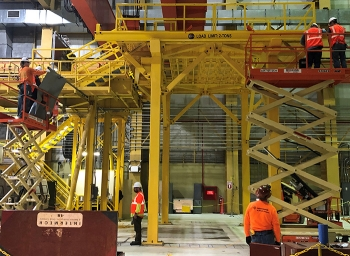 At the Maintenance and Storage Facility on the Hanford Site, crews are removing old infrastructure to make room to build a mock-up of a system that will transfer radioactive capsules from underwater storage to dry storage.