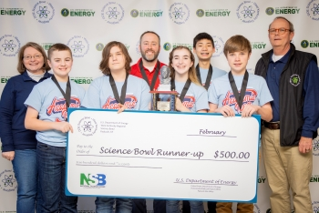 Calloway County Middle School placed second. Pictured left to right: DOE Paducah Site Lead Jennifer Woodard, Connor Pile, Aidyn Reed, Coach Scott Pile, Olivia Anderson, Aiden Grooms, Gary Rogers and DOE Strategic Planner Buz Smith.