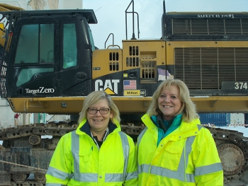 Lettie Chilson, left, CH2M HILL BWXT West Valley (CHBWV) facility manager, and Janice Williams, CHBWV vice president of regulatory strategy, stand in front of a cleanup project at EM's West Valley Demonstration Project.