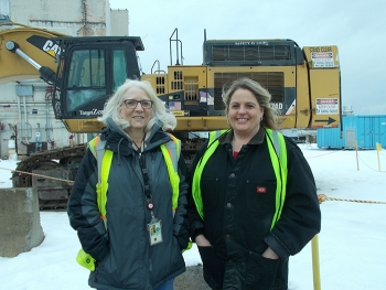 Pam Walters, left, CH2M HILL BWXT West Valley (CHBWV) operations manager, and Cheryl Wozniak, CHBWV safety engineer, stand near a structure scheduled for demolition at EM's West Valley Demonstration Project.