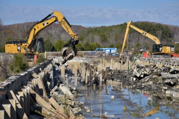 Crews remove concrete subsurface structures of the K-832 basin at Oak Ridge in 2019 and pumped nearly 2 million gallons of water from the basin before beginning demolition.
