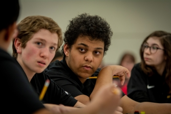 Lone Oak Middle School Team One members Owen Cody and Cole Cannon listen for the question during a round at the DOE Regional Science Bowl Middle School competition.