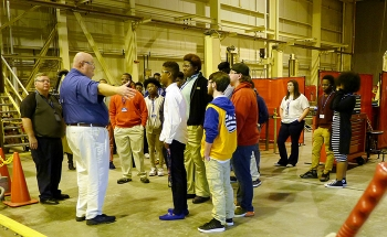 Chip Jenison, Savannah River Nuclear Solutions mechanical shops manager, describes the day-to-day work of a maintenance mechanic to students from the Richmond County School System during their tour of the Savannah River Site.