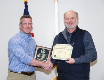 Mark Smith, director of the waste disposition engineering division at DOE-Savannah River (DOE-SR), presents the Safety System Oversight Engineer of the Year award to William Satterfield.