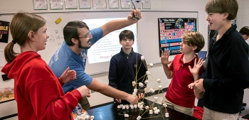 Savannah River Nuclear Solutions Engineer Graham Jones measures the height of a tower built using only marshmallows and uncooked noodles during a Savannah River Site teach-in at the Episcopal Day School in Augusta, Georgia.