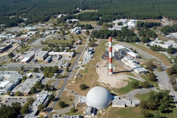 The red-and-white High Flux Beam Reactor exhaust stack — a pronounced part of the Brookhaven National Laboratory skyline for more than 70 years — is slated for demolition later this year.