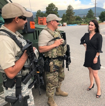Unica Viramontes talks security with LANL security guards.