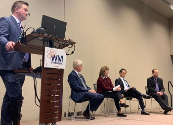"""EM managers tackled a variety of questions from the audience and moderator Martin Schneider of Longenecker and Associates (standing) during the """"Hot Topics"""" panel at the Waste Management Symposia."""
