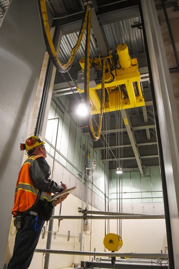 Julian Leam, senior mechanical handling test engineer with Waste Treatment Completion Company, observes as a transfer hoist is remotely operated from the Hanford Low-Activity Waste Facility control room.