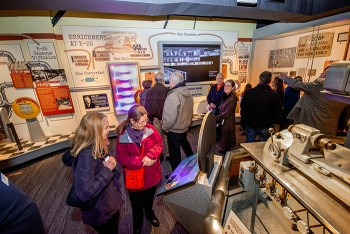 Visitors explore the many exhibits and interactive displays in the K-25 History Center.