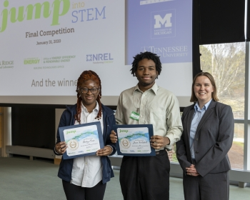 The winning team from Clark Atlanta University (From Left: Destiny Currie and James Whitfield) stand with JUMP into STEM Director Mary Hubbard.