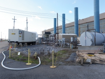 BEFORE: Pictured here are the equipment, tanks, and other items on the east side of the C-400 Building.