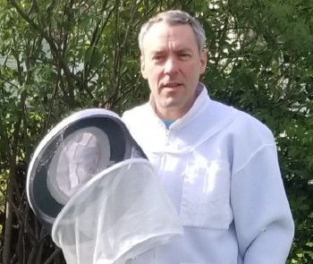 NNSA's Randy Weidman and some of the apparel he needs to maintain his beehives.
