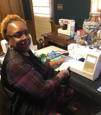 Cassandra Jones, an information security specialist at NNSA's Savannah River Field Office, sews masks to share with others during the coronavirus pandemic.