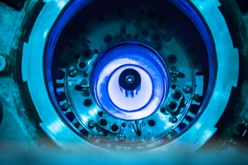 The blue glow at the center of a research reactor at Oak Ridge National Laboratory. The glow is created by electrons emitted in radioactive decays in the radioactive core.
