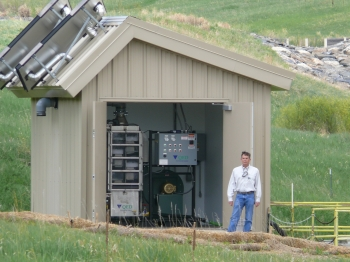 John Boylan working with the Rocky Flats Site solar-powered water treatment system.