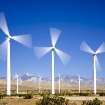 Wind farm against a clear blue sky.