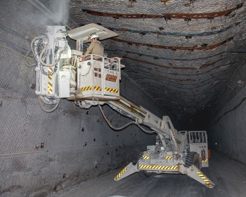 A miner at the Waste Isolation Pilot Plant (WIPP) installs a roof bolt 2,150 feet below the surface in the WIPP underground. WIPP is the nation's only repository for the permanent disposal of defense-generated transuranic waste.