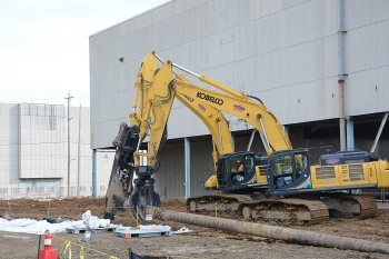 Removing high-pressure fire water lines from the perimeter of the X-326 Process Building at the Portsmouth Site