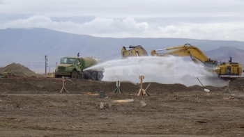 Workers applying a fixative at Hanford Richland site