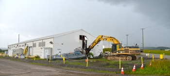 Demolition begins on Building K-2500-H. The facility was located near the massive K-25 gaseous diffusion building and supported demolition efforts for that project.