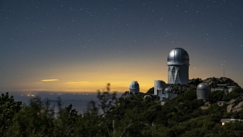 "The Dark Energy Spectroscopic Instrument at the Mayall Telescope at Kitt Peak National Observatory will use 5,000 robotic ""eyes"" to map the history of cosmic expansion."