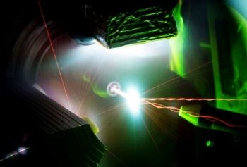 Invisible infrared light from the 200-trillion-watt Trident Laser enters from the bottom to interact with a one-micrometer thick foil target in the center of the photo, generating a high energy density plasma.