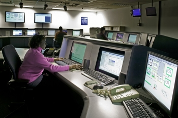 Janice Sandford, forefront, and other operators are shown in the Defense Waste Processing Facility control room. Savannah River Remediation recently upgraded its control system hardware and software.