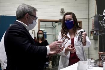 Emma White, Associate Scientist at Ames Laboratory, meeting Secretary Dan Brouillette in June 2020.