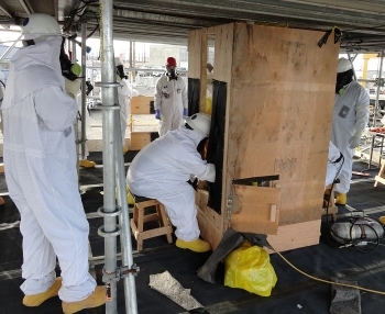 Washington River Protection Solutions workers use shielding to remove a highly contaminated thermocouple from a Hanford tank farm. Planning and mock-ups significantly reduced potential exposure risks while removing thermocouples.