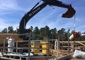 Workers prepare equipment removed from a recently demolished contaminated structure at the Savannah River Site to be permanently encapsulated within cement-like grout.