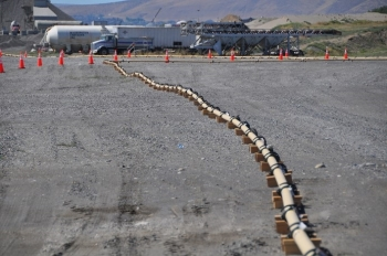 The EM Richland Operations Office and its contractor CH2M HILL Plateau Remediation Company are testing a conveyance system that will pump engineered grout through more than 1,500 feet of pipe to three underground at-risk structures at the Hanford Site.