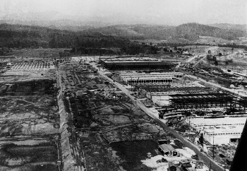 An aerial view of the K-25 Building's construction at Oak Ridge during the Manhattan Project. In 18 months, workers built the world's largest building, and its gaseous diffusion technology proved to be the preferred enrichment method during the Cold War.