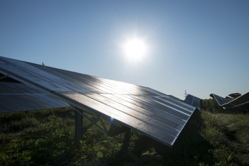 The sun shining on photovoltaic panels.